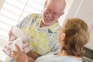 Caring for Caregivers | Elderly couple washing dishes.