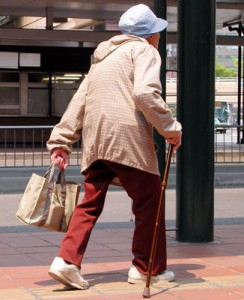 Woman walking with a cane | Activities of daily living for Alzheimer's disease